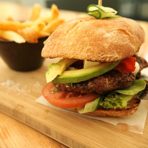 beef burger with avo and chips